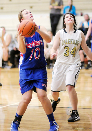Elwood's Kelsey Hughes looks to shoot as Daleville's Jordyn Marshall looks to rebound as the Broncos hosted the Panthers on Thursday.