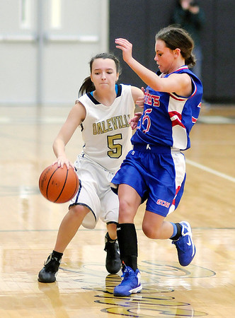 Daleville's Brandi Granger brings the ball down court as she is guarded by Elwood's Jessie Noone as the Broncos hosted the Panthers on Thursday.