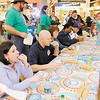 Competing in a Girl Scout Cookie eating contest at Mounds Mall on Saturday from left are Judge Angela Warner Sims, Big Time Bounce owner Brent Doster, Rev. Donna Goings, Fire Chief Phillip Rogers and retired Fire Chief J.R. Rosencrans. Doster won, eating 26 cookies in two minutes.