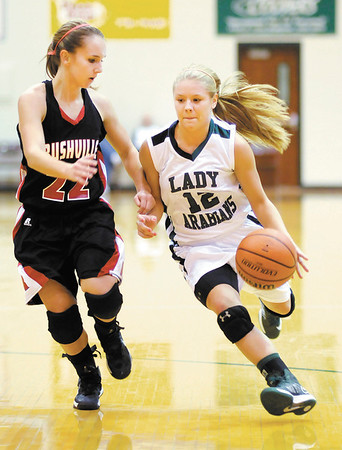 Pendleton Heights' Tiffany Wertz drives against the defense of Rushville's Mikayla Dougherty as the Arabians hosted the Lions on Saturday.