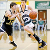 Pendleton's Sean McDermott drives as he is guarded by Shelbyville's Tyler Land on Saturday.