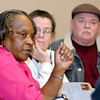 Former Arbor Village apartment tenant Barbara Currie talks about the problems she had with the owners of the apartments as former tenants Linda and Jim Reeves listen.