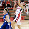 Frankton's Katie Key drives for a layup against Tipton's Kacie Juday as the Eagles hosted the Blue Devils on Thursday.