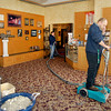 THB photo/John P. Cleary<br /> Warren Wasson of Service Master Clean uses a water extractor to suck up  moisture out of the carpet in the gift shop and concession area of the Paramount Theatre Center Thursday morning after a water line broke overnight flooding the Marquee Room and damaging the concession area.