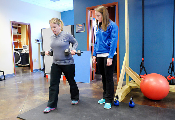 Don Knight / The Herald Bulletin<br /> Trainer Keri Phillips works with Nyria Molina at the White River Club on Thursday.