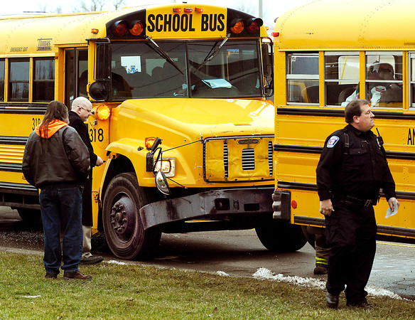 THB photo/John P. Cleary<br /> Joe Cronk, ACS chief operating officer, looks over the damage after these two school buses were involved in a accident sending six students to the hospital Monday afternoon.