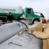 THB photo/John P. Cleary<br /> Brandon Fuller and Dan Stinson pump out propane from two tanks on a farm on East 400 North Friday reclaiming the gas for redistribution due to the propane shortage in the area.