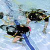 Megan Farver swims underwater with instructor Les Hiatt during the introductory scuba diving class at the YMCA.
