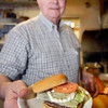 THB photo/John P. Cleary<br /> Bill Pitts, owner of The Lemon Drop, serves up a hamburger the way it has been done for the 60 years the restaurant has been in business.