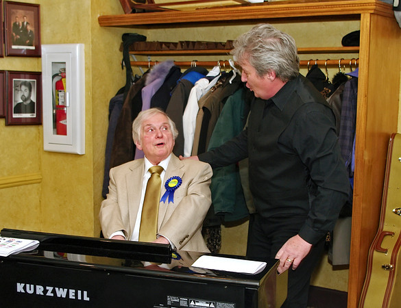 Paramount Theatre staff organist and music store owner George Smith harmonizes with local musician Woody  Wright during the surprise 80th birthday roast honoring George held on January 26, 2104.
