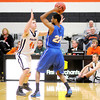 Don Knight / The Herald Bulletin<br /> Anderson's Nate Gross guards Mount St. Joseph's Femi Thompson on Wednesday.