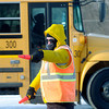 Don Knight / The Herald Bulletin<br /> Stanley Dewitt with the Anderson Auxiliary Police stops northbound traffic on Raible Avenue as buses leave at the end of the school day at Anderson Elementary on Thursday. Extreme cold temperatures and wind chill meant you had to bundle up in layers to be outside on Thursday.