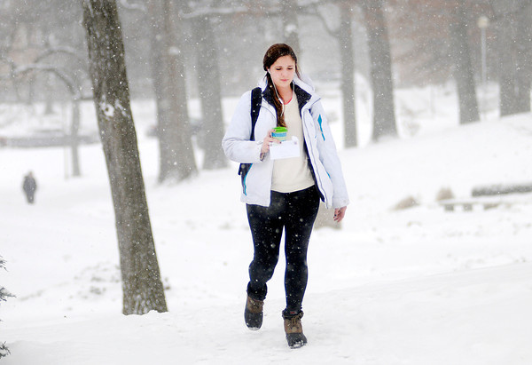 Don Knight / The Herald Bulletin<br /> Anderson University student Olivia Lacy walks across campus as a fresh blanket of snow covers campus on Thursday. Classes for the Spring semester started on Wednesday.