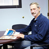 Don Knight / The Herald Bulletin<br /> Bob Anders at the local SCORE chapter in the Union Building were he offers advice to people wanting to start their own business.