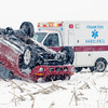 Don Knight / The Herald Bulletin<br /> A jeep Liberty rests on its roof in a corn field south of County Road 300 North West of 200 West Saturday afternoon. No one was seriously injured in the accident.