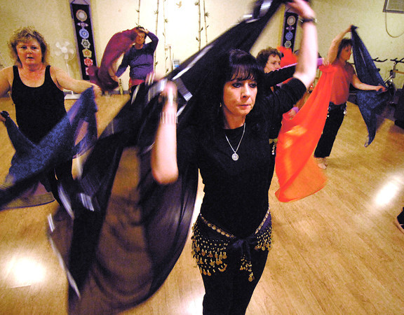 THB photo/John P. Cleary<br /> Students go through the moves of a dance in Tatiana Smith's belly dancing class at Yoga For Everyone at 12 E. Cross Street in Anderson.