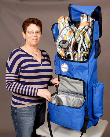 THB photo/John P. Cleary<br /> Lisa Rice with her invention the Rollngo, a accessory bag on wheels for all outdoor occasions.  It holds two folding chairs, has a detachable cooler, an umbrella holder, an insulated wine holder, and storage space inside and out with a retractable handle.