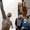 THB photo/John P. Cleary<br /> Johnny Wilson and Carl Erskine look over the clay model of Jumping Johnny that will become a statue of the basketball legend in Ken Ryden's art studio.  Ryden was commissioned to create the statue for the Impact Center.