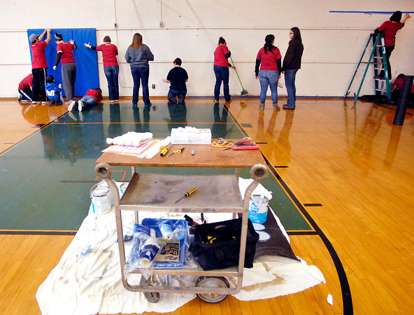 THB photo/John P. Cleary<br /> Anderson University students did community service projects around town as part of celebrating Martin Luther King Jr. Day.  Here students work to prepare to paint the wall of the gym at the Park Place Community Center Monday afternoon.