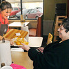 THB photo/John P. Cleary<br /> Captain D's employee Missy Phipps serves Lynn Melson her lunch on the first day the restaurant was back open after being closed for one year due to a fire that destroyed the business.