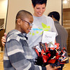 THB photo/John P. Cleary<br /> Highland Middle School sixth grader Donte' King, 12, shows the candy basket he received to Kristal McCorkle, Highland Middle School Sparrow Club adviser, after the school convocation in which the Sparrow Club concept was explained and  Donte' was introduced to the student body as the school's first sparrow.<br /> The students can help earn money by doing community service and logging the hours.  For each hour served the sponsor puts $10 into an account for the sparrow's needs, in this case Donte' needs a new kidney.