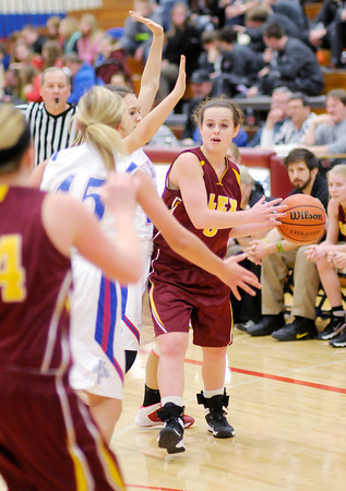 Don Knight / The Herald Bulletin<br /> Alexandria's Courtney Skinner looks to pass as Elwood hosted the Tigers for a  on Friday.
