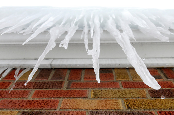 Don Knight / The Herald Bulletin<br /> Icicles hanging from an ice dam begin to thaw during last week's warm up.