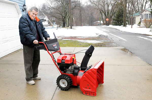 Don Knight / The Herald Bulletin<br /> Lee Robinson, 81, didn't let last weeks extreme cold stop him from using his snow blower to clear his driveway and walks and helping his neighbors clear theirs.