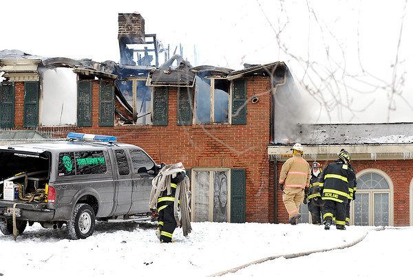 THB photo/John P. Cleary<br /> Firefighters used a 4x4 pickup to transport and drag fire hose up a hill to the house at 11 Flyntwood Drive after a overnight blaze rekindled Wednesday morning sending fire units back to scene.