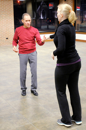 """Don Knight / The Herald Bulletin<br /> Ron McNabney and Monica Lung rehearse for the opening number for this year's """"Dancing Like the Stars."""""""