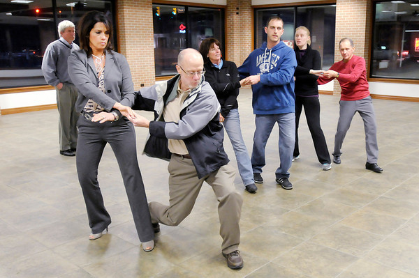 "Don Knight / The Herald Bulletin<br /> Dancers rehearse their opening number for this year's ""Dancing Like the Stars."" From left are Lisa Putnam, Bill Kopp, Jeanne Fredericks, Zach Kerr, Monica Lung and Ron McNabney."