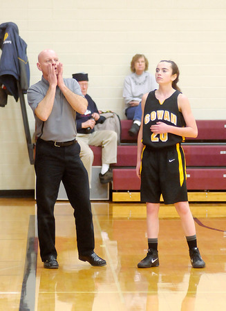 Don Knight / The Herald Bulletin<br /> Carli Skinner stands next to her dad, Cowan Head Coach John Skinner, during a free throw as the Tigers hosted Cowan on Thursday.
