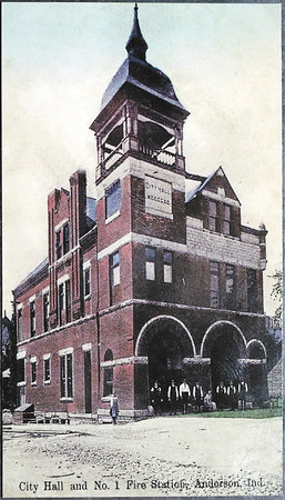 The front of Carl Greenlee's unique business card is a replica of an antique picture postcard showing the old Anderson City Hall and Number One Fire Station.