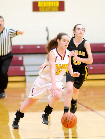 Don Knight / The Herald Bulletin<br /> Alexandria's Courtney Skinner brings the ball down court as the Tigers hosted Cowan on Thursday. Behind Courtney is her sister Cowan's Carli Skinner.