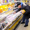 Don Knight / The Herald Bulletin<br /> Jack Craig of Anderson picks up a few items at the Harvest Supermarket on Eighth Street ahead of the snow storm forecast to arrive on Sunday.