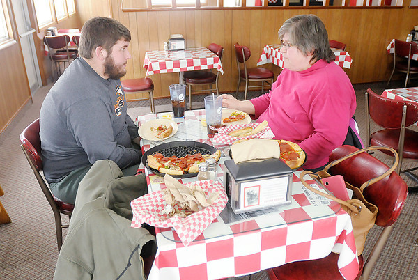 Don Knight / The Herald Bulletin<br /> Catherine and Ty Palmer of Indianapolis eat lunch at Greek's Pizzaria in Anderson on Thursday. Ty is a student at Anderson University.