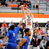Don Knight / The Herald Bulletin<br /> Anderson's Cody Jackson shoots as the Ravens hosted Mount St. Joseph on Wednesday.