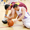 Don Knight / The Herald Bulletin<br /> Elwood's Jared Bourff and Alexandria's Jake Thurston scramble for a loose ball on Friday.