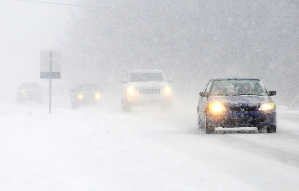 Don Knight / The Herald Bulletin<br /> Heavy snow reduces visibility on Indiana 32 in Edgewood during Saturday's snow storm.