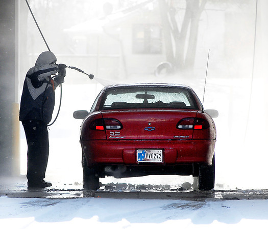 THB photo/John P. Cleary<br /> With a period of sunshine Friday this person took advantage of it to clean off the winter road grime from his vehicle at the Zalo Kar Wash at Nichol and Madison Ave. Friday afternoon.  It won't be to soon as the National Weather Service forcasts 1-3 inches of new snow to fall over the area Saturday.