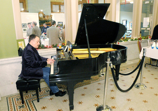 """Don Knight / The Herald Bulletin<br /> Rick Vale plays piano during the """"Toasting the New Year Sampler"""" at the Anderson Center for the Arts on Friday. Proceeds from the event benefited the Anderson Center for the Arts, Anderson Symphony Orchestra, Anderson Young Ballet Theatre and the Paramount Theatre."""