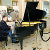 "Don Knight / The Herald Bulletin<br /> Rick Vale plays piano during the ""Toasting the New Year Sampler"" at the Anderson Center for the Arts on Friday. Proceeds from the event benefited the Anderson Center for the Arts, Anderson Symphony Orchestra, Anderson Young Ballet Theatre and the Paramount Theatre."