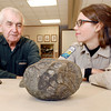 THB photo/John P. Cleary<br /> Forrest Bricker talks with Jessica Rosier, interpretive naturalist at Mounds State Park, about his thoughts on the origin of this 10 pound rock that was returned to the park after being taken 70 years ago.