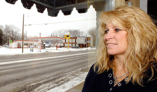 THB photo/John P. Cleary<br /> Kara Crisler, office manager of Hart Properties, looks out her window at 616 East 8th Street in Anderson with the closed Swifty gas station across the street.