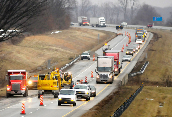 Don Knight / The Herald Bulletin<br /> Southbound traffic on Interstate 69 is reduced to one lane in this view from the overpass at County Road 650 West on Tuesday. Contractors are replacing a section of damaged pavement and both lanes of traffic are expected to reopen by Thursday morning according to the Indiana Department of Transportation.