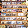 """A display rack of """"Carl's Cards"""" from the postcard collecting hobby-turned-business of retired Anderson firefighter and former chief Carl Greenlee."""
