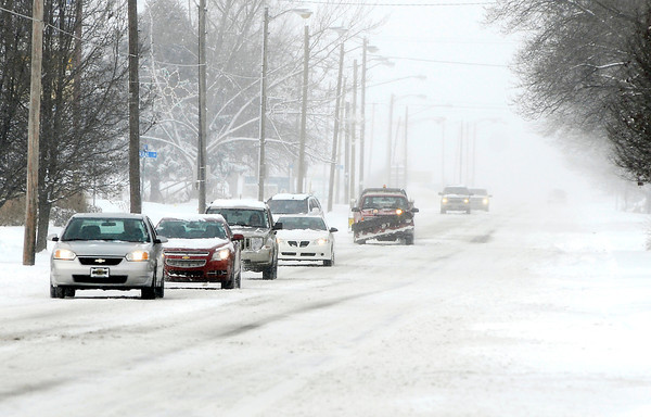 THB photo/John P. Cleary<br /> Roads were snow covered and hazardous throughout the area after about 5 inches of snow fell overnight.