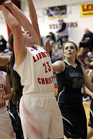 Photo by Chris Martin for The Herald Bulletin<br /> Liberty Christian's Ellie Whitaker is fouled trying to score off of a rebound.
