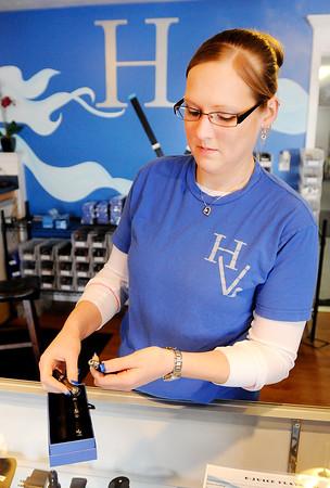 Don Knight | The Herald Bulletin<br /> Erica Barnett demonstrates an e-cigarette at Hoosier Vapes on 53rd Street in Anderson.