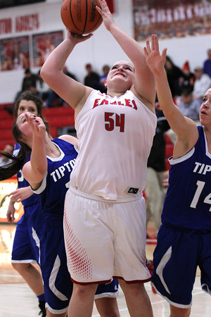 Chris Martin | For The Herald Bulletin<br /> Frankton's Kaylee Irwin puts a rebound back up Thursday night in a win against Tipton